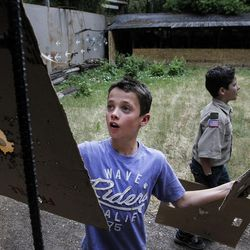 Jonah Leavitt, 11, checks out his target after practicing his aim at the firing range during activity time at Camp Tracy in Mill Creek Canyon on Friday, July 22, 2016.