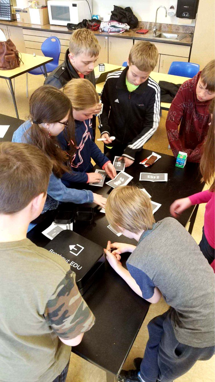 Students participate in an interactive puzzle game at the Colorado AeroLab.