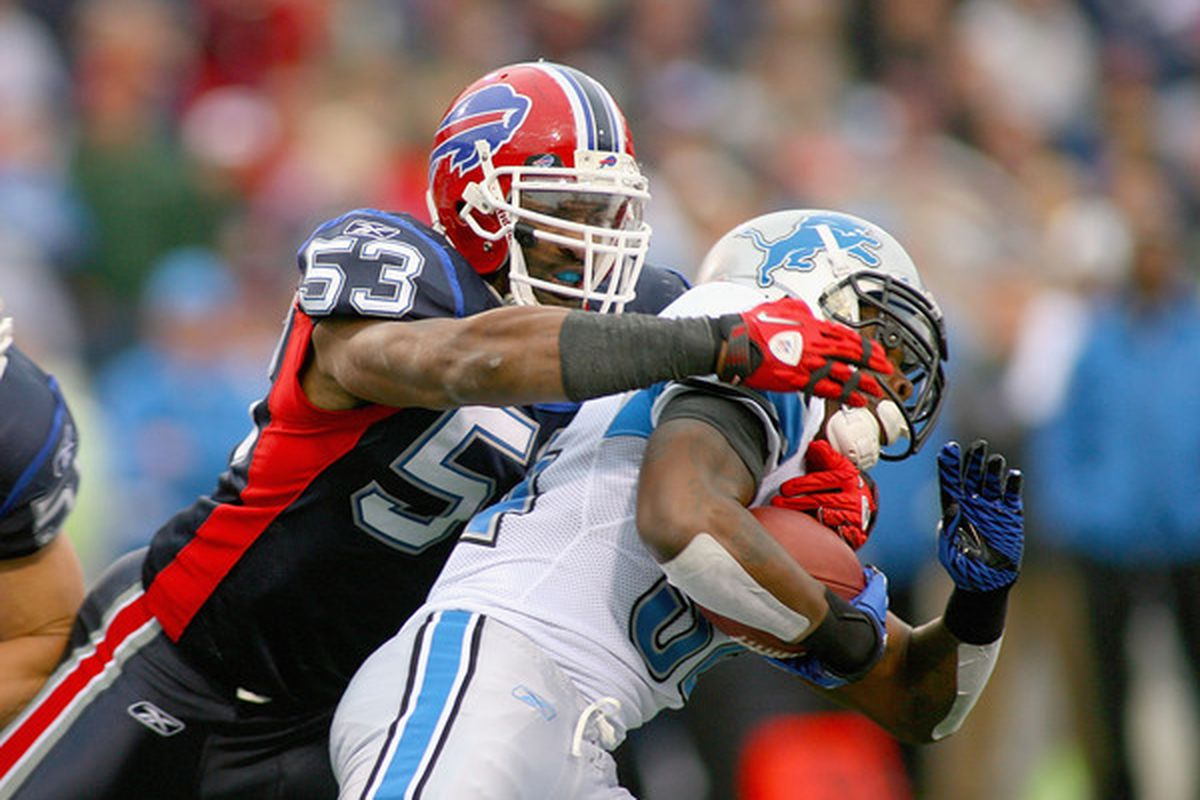 ORCHARD PARK NY - NOVEMBER 14: Reggie Torbor #50 of the Buffalo Bills tackles Kevin Smith #34 of the Detroit Lions at Ralph Wilson Stadium on November 14 2010 in Orchard Park New York.  (Photo by Rick Stewart/Getty Images)