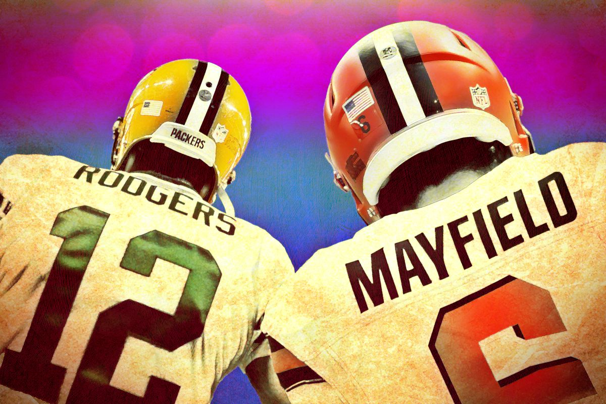 The backs of Aaron Rodgers and Baker Mayfield
