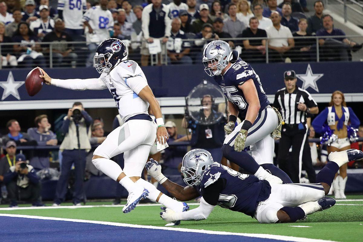 Tennessee Titans quarterback Marcus Mariota scores a touchdown