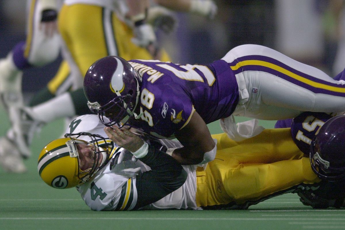 GENERAL INFORMATION: Minnesota Vikings vs. Green Bay Packers at home ñ 10/21/2001 IN THIS PHOTO: Vikings linebacker Ed McDaniel slams down Brett Favre, after Favre had fumbled the ball and then picked it up to launch an incomplete pass.