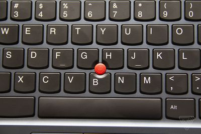 The TrackPoint in the center of the keyboard of the Lenovo ThinkPad C13 Yoga Chromebook.