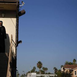 Rev. Joseph Boules, left, walks down the steps to lead a mass at St. Mary and St. Verena Orthodox Coptic Church in Anaheim, Calif., Wednesday, Sept. 19, 2012.