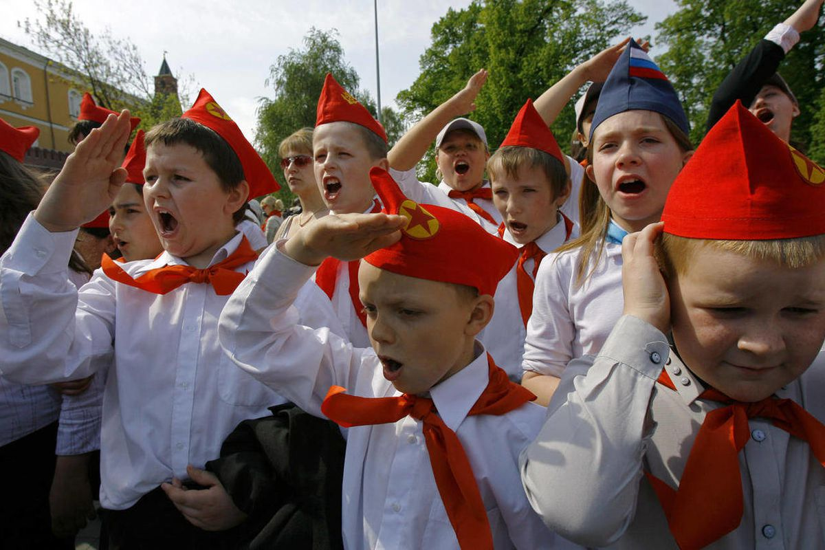 FILE - In this May 19, 2007 file photo, teenagers, members of the Young Pioneers, salute during a ceremony of joining the organization in Moscow. When Anders Behring Breivik, the far-right suspect in the massacre of 77 people in Norway, pulled his right h