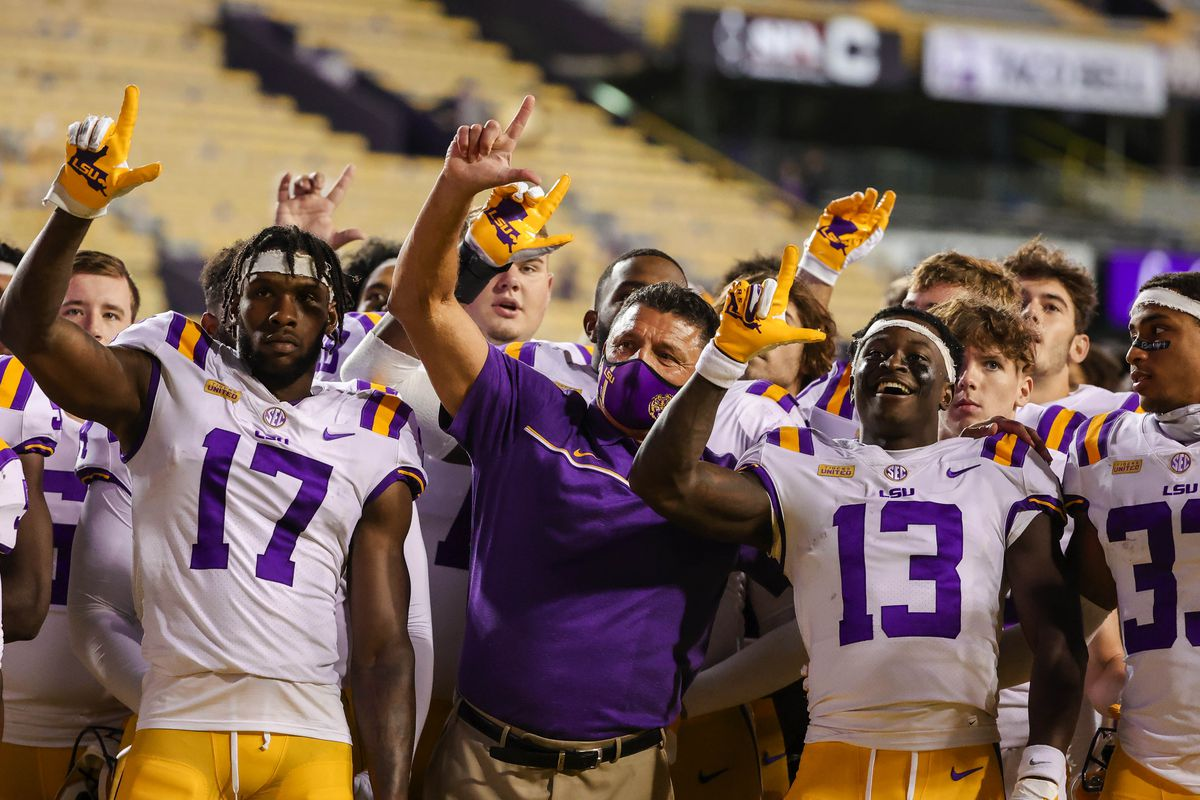 LSU Tigers head coach Ed Ogeron sings with his team following a 52-24 win against the South Carolina Gamecocks at Tiger Stadium.