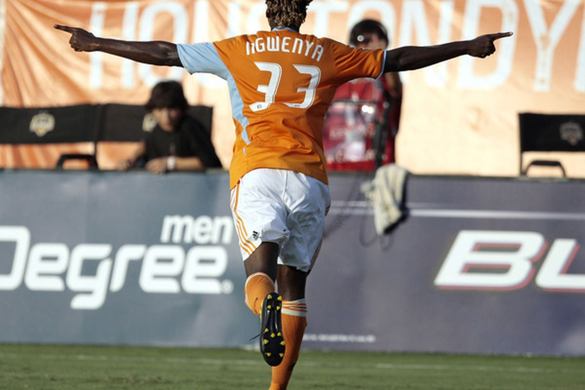 HOUSTON - JULY 15:  Joseph Ngwenya #33 of the Houston Dynamo celebrates after scoring in the first half against Pachuca CF at Robertson Stadium on July 15 2010 in Houston Texas.  (Photo by Bob Levey/Getty Images)