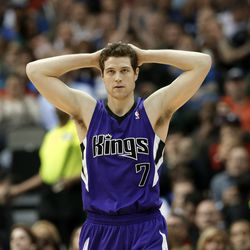 Sacramento Kings point guard Jimmer Fredette (7) looks up court after being charged with a foul against the Dallas Mavericks in the first half of an NBA basketball game, Friday, Jan. 31, 2014, in Dallas.