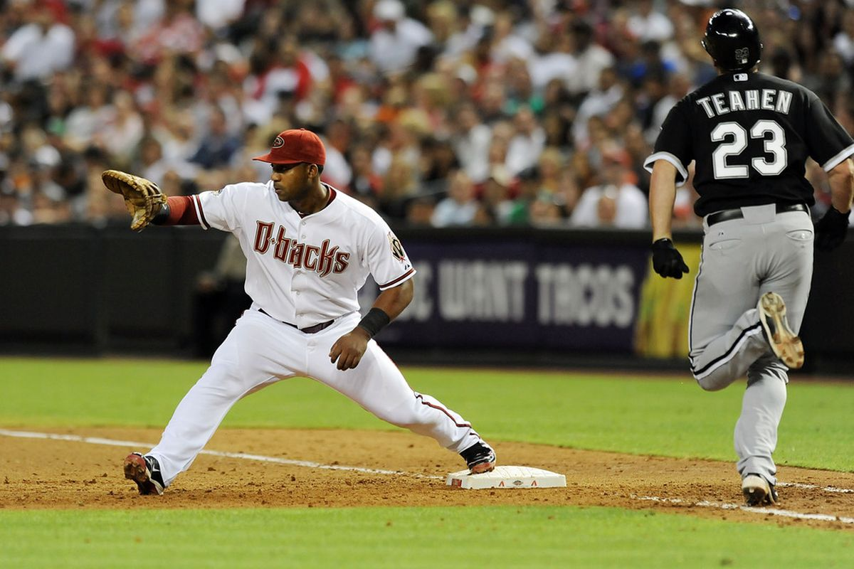 Juan Miranda (remember him?) stretches out to catch the throw ahead of a sprinting Mark Teahen at Chase Field on June 17, 2011.