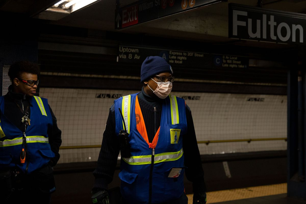 An MTA worker wears a surgical mask on the Fulton Street A/C platform.