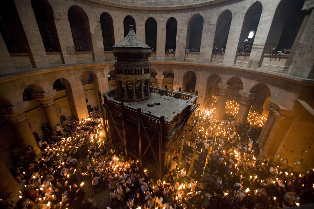Orthodox Christian pilgrims hold candles at the Church of the Holy Sepulcher, traditionally believed to be the site of the crucifixion of Jesus Christ, during the Holy Fire ceremony, in Jerusalem's Old City, Saturday, April 3, 2010.