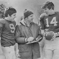 BYU head football coach LaVell Edwards talks with Jeff Nilsson and Gifford Nielsen on April 10, 1976.