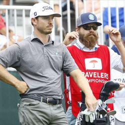 Bronson Burgoon and his caddie wait on the first tee in the 2019 Travelers Championship Third Round at the TPC River Highlands in Cromwell, CT on June 22, 2019.