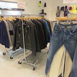 Men have three racks of sales items, including that Margiela leather biker jacket for $499.50