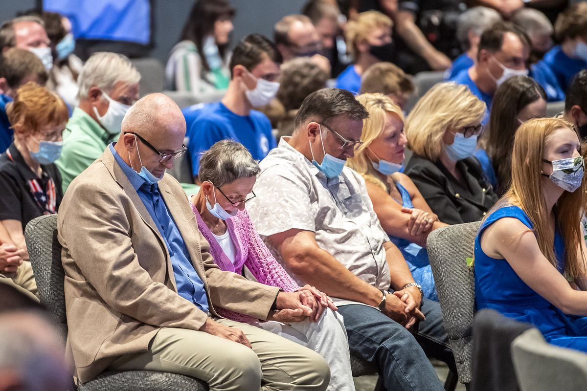 In this file photo from Sept. 9, 2020, people attending an event with Vice President Mike Pence, pray before he took the stage to speak to Marjorie Dannenfelser, president of the Susan B. Anthony List, an anti-abortion group, at Cornerstone Ministries church, in Export, Pa. a Pittsburgh suburb.