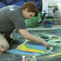 Nicole Kleinman works on her chalk art during the fourth year of Chalk the Walk in West Jordan on Saturday, Sept. 5, 2020. The County Library welcomed chalk artists and their fans to participate in the library's first in-person event since COVID-19 measures went into effect in March.