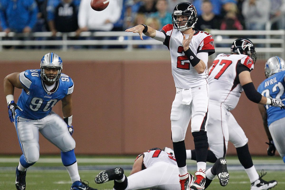 DETROIT, MI - OCTOBER 23:  Matt Ryan #2 of the Atlanta Falcons throws a pass in front of Ndamukong Suh #90 of the Detroit Lions at Ford Field on October 23, 2011 in Detroit, Michigan. Atlanta won the game 23-16. (Photo by Gregory Shamus/Getty Images)