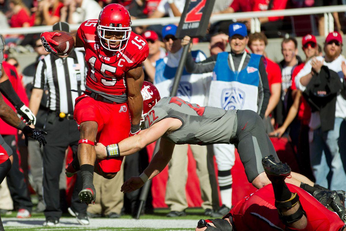 November 3, 2012; Salt Lake City, UT, USA; Utah Utes running back John White (15) avoids the tackle of Washington State Cougars safety Casey Locker (22) during a touchdown run in the first half at Rice-Eccles Stadium.