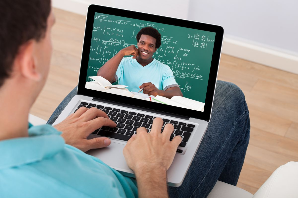 Man watching lecture on his laptop
