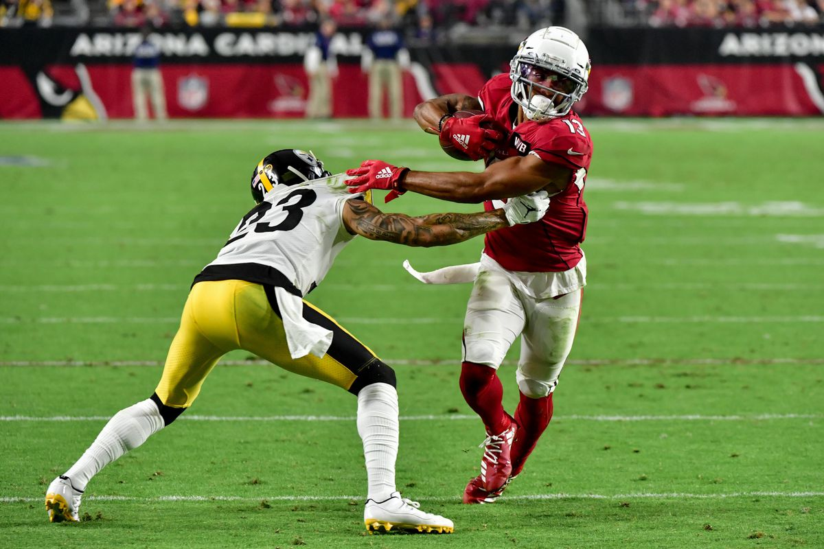 Arizona Cardinals wide receiver Christian Kirk carries the ball as Pittsburgh Steelers cornerback Joe Haden defends during the second half at State Farm Stadium.