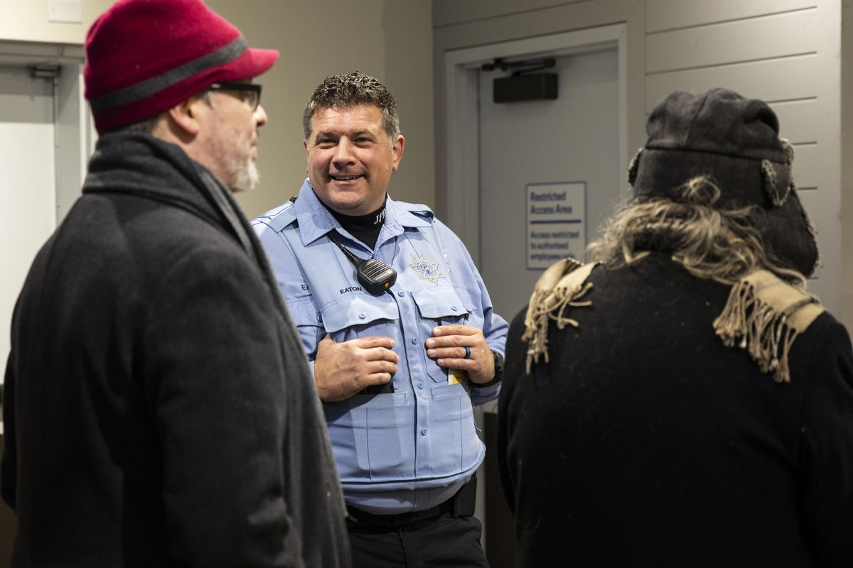 Joliet Police Officer Jeremy Eaton chats with customers at Rise Joliet, a cannabis dispensary in southwest suburban Joliet, on the first day of legalized recreational marijuana in Illinois, Wednesday, Jan. 1, 2020.