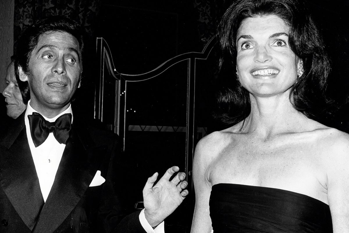 Valentino with Jacqueline Kennedy Onassis in 1976. Photo: Getty Images