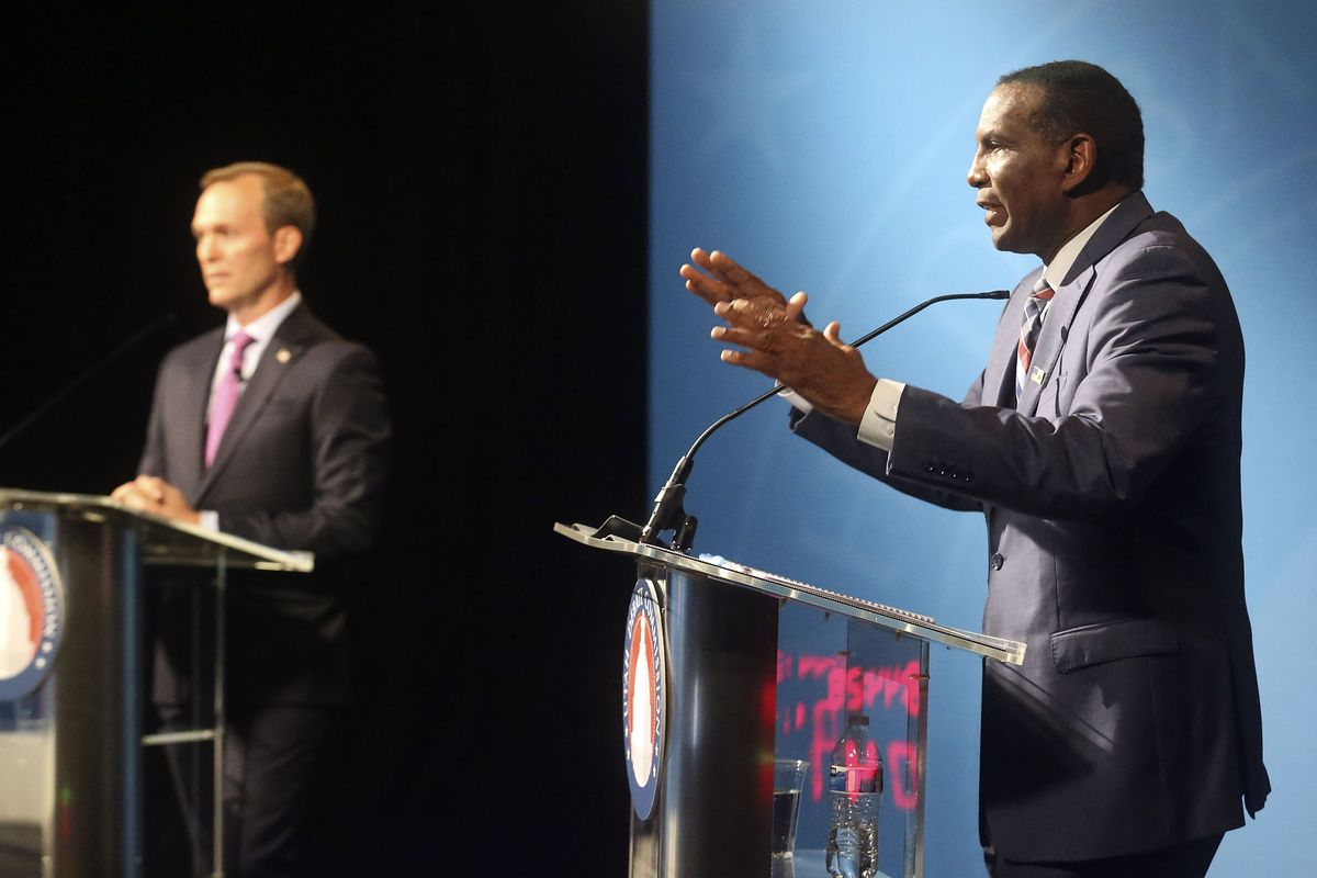 Burgess Owens, 4th Congressional DistrictRepublican candidate, participates in a Utah Debate Commission debate with his opponent Rep. Ben McAdams, D-Utah, left, at the Triad Center in Salt Lake City on Monday, Oct. 12, 2020.