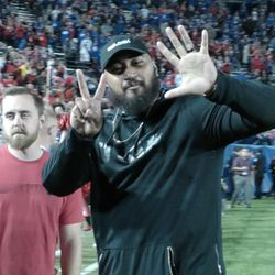 """Former Utah offensive guard Isaac Asiata flashes a """"seven"""" sign, signifying the Utes' seventh straight win over BYU, following Utah's 19-13 victory over the Cougars on Saturday, Sept. 9, 2017, at LaVell Edwards Stadium."""
