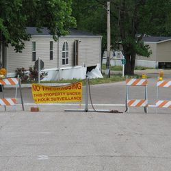 """A """"No Trespassing"""" sign and striped barricades block the entrance of Memphis Mobile City, a mobile home park that has been closed since it was flooded last year, on Friday, April 20, 2012 in Memphis, Tenn.  Emergency officials in Memphis are teaming up with federal agencies to create a network of river gauges and weather monitoring stations along Mississippi River tributaries to better monitor the waterways that overflowed and caused hundreds to evacuate their homes last year."""