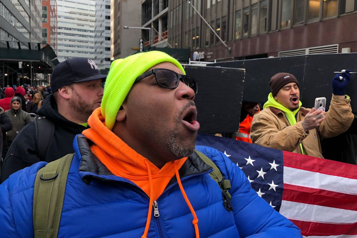 Union construction workers carry coffins through the financial district to protest worker deaths, March 14, 2018.