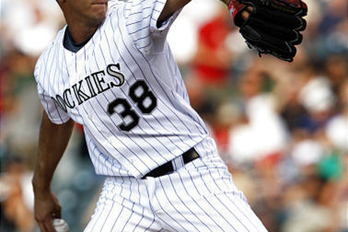 Colorado Rockies starting pitcher Ubaldo Jimenez works against the Pittsburgh Pirates in the first inning of a baseball game in Denver on Wednesday.