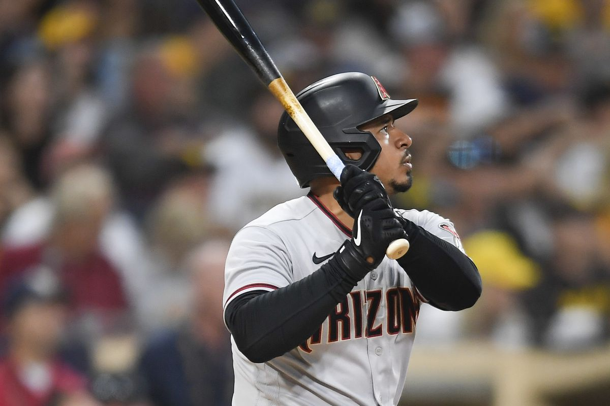 Eduardo Escobar #5 of the Arizona Diamondbacks hits a two-run home during the third inning of a baseball game against the San Diego Padres at Petco Park on June 26, 2021 in San Diego, California.