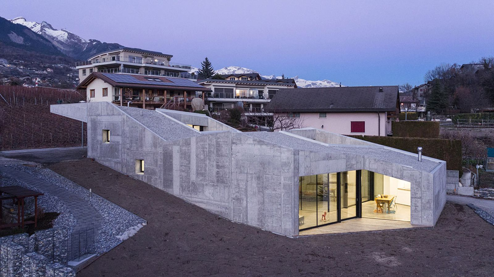 Concrete home climbs up small sloping site in switzerland for Modern house website