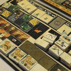 Players attempt to accumulate various kinds of tiles to promote their civilization in Rise of Empires, from Mayfair Games.