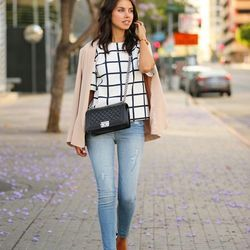 """Annabelle of <a href=""""http://vivaluxury.blogspot.com""""target=""""_blank"""">Viva Luxury</a> is wearing <a href=""""http://www.express.com/clothing/high+rise+destroyed+ankle+jean+legging/pro/7166192/cat430020""""target=""""_blank"""">Express</a> pants, Schutz shoes, a Truth"""