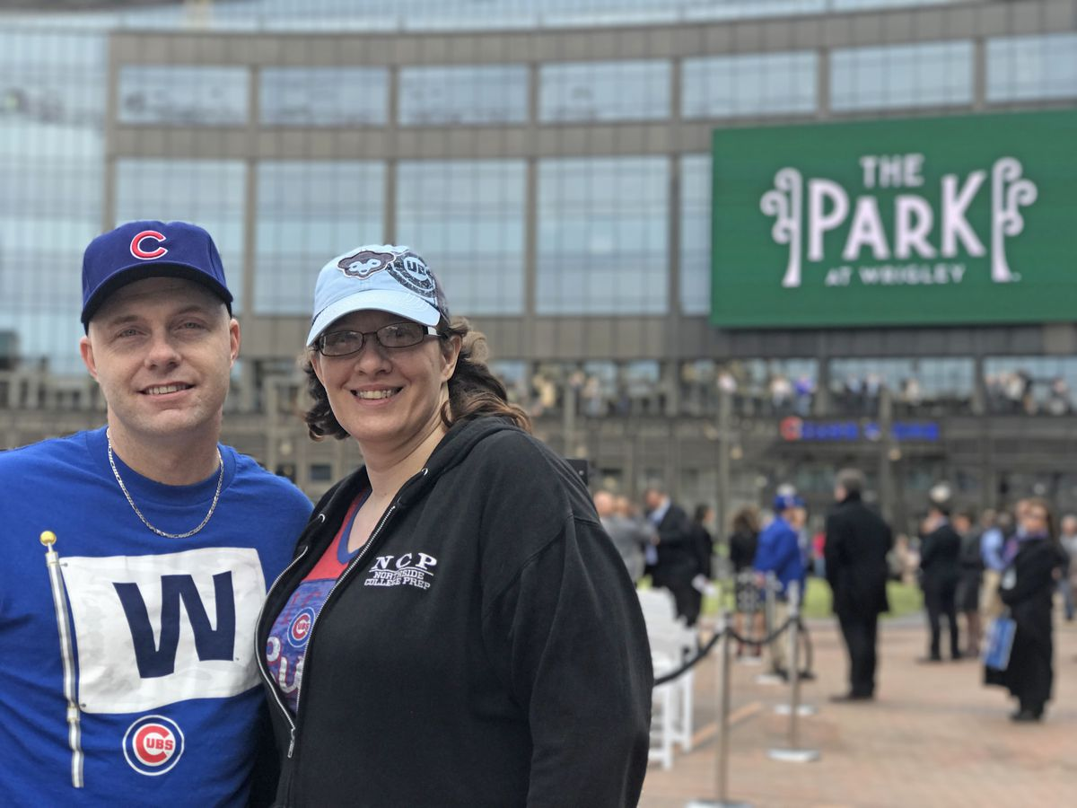 """Edward Savitzky, 41, and his wife Bernadette Savitzky,42, attend the ribbon-cutting ceremony of the new plaza outside Wrigley Field. Bernadette called the recent development in the area around Wrigley a """"grownup's Disneyland"""" or """"Cubbieland.""""   Andrea Sal"""