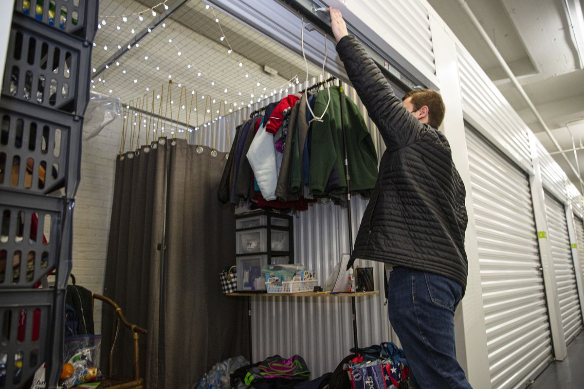 Colin McCormick closes a storage unit used to store clothing and other items for immigrants transported to Chicago from the border, Wednesday, April 21, 2021.