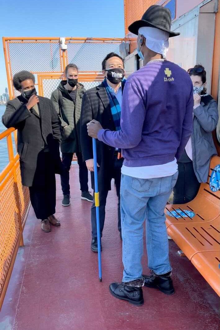 Mayoral candidate Andrew Yang deescalates a situation after a man holding a pole attacked a photojournalist on the Staten Island Ferry Friday morning, Feb. 26, 2021.