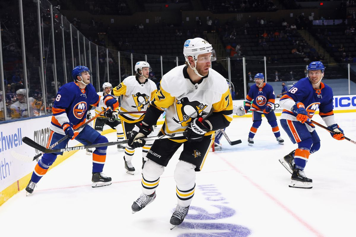 Jeff Carter #77 of the Pittsburgh Penguins skates against the New York Islanders in Game Four of the First Round of the 2021 Stanley Cup Playoffs at the Nassau Coliseum on May 22, 2021 in Uniondale, New York. The Islanders defeated the Penguins 4-1.