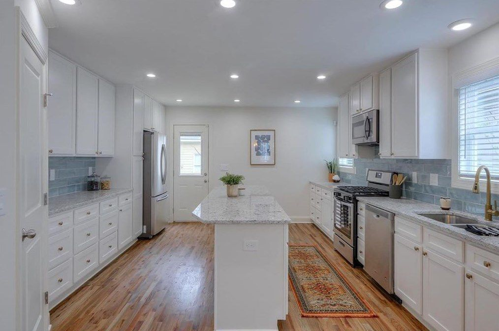 A white and blue large kitchen.