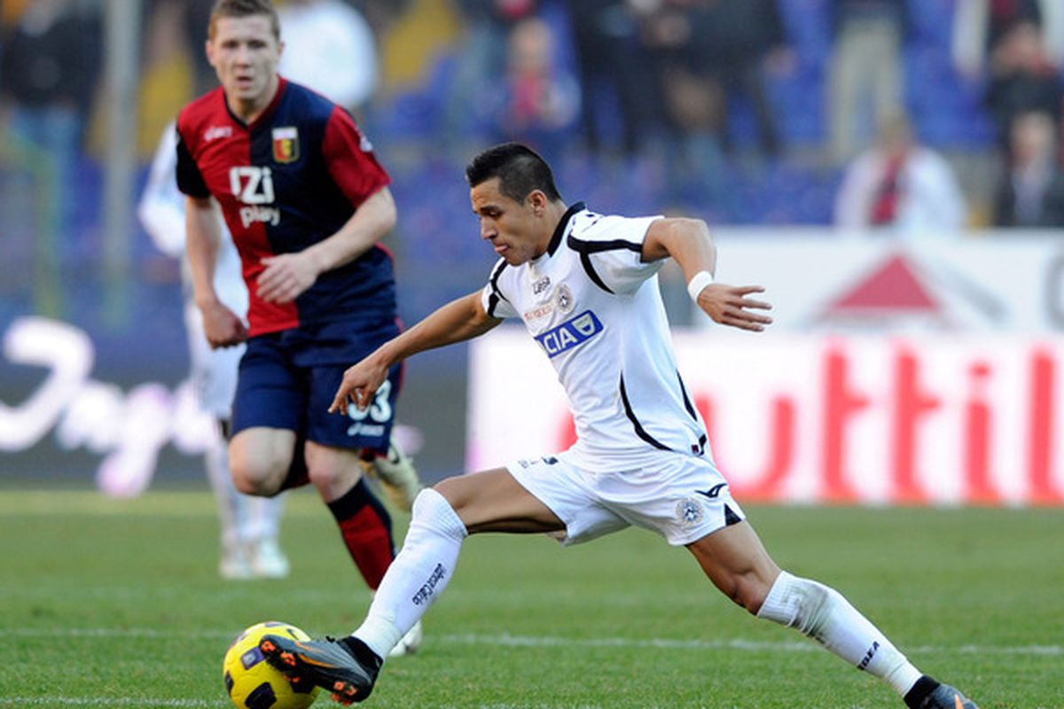 GENOA ITALY - JANUARY 16:  Alexis Sanchez of Udinese Calcio kicks during the Serie A match between Genoa and Udinese at Stadio Luigi Ferraris on January 16 2011 in Genoa Italy.  (Photo by Claudio Villa/Getty Images)