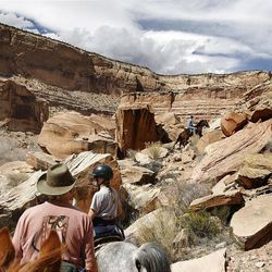 Some of the riding includes rocky terrain while riding horses down the Little Grand Canyon of the San Rafael Swell  Saturday, April 2, 2011, in the San Rafael Swell in Central Utah.