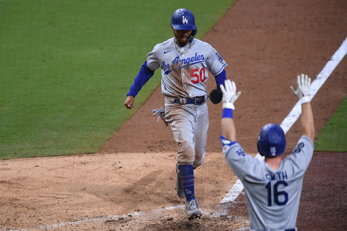 Los Angeles Dodgers right fielder Mookie Betts (50) scores a run on a single by third baseman Justin Turner (not pictured ) during the ninth inning against the San Diego Padres at Petco Park.