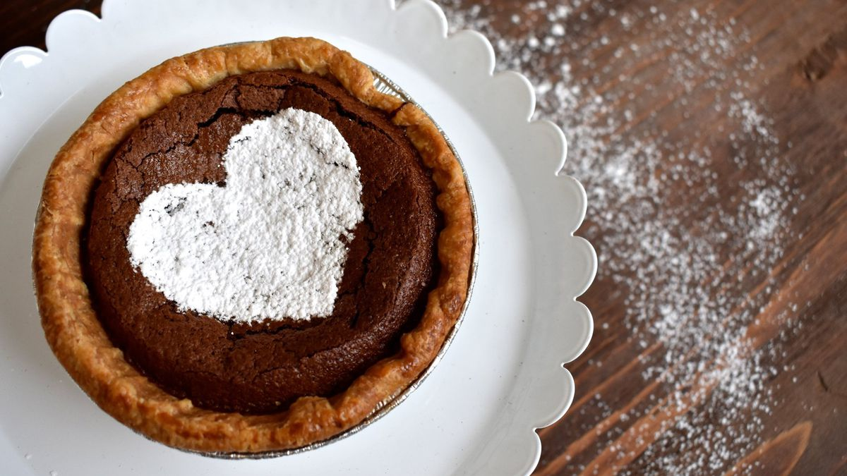 A chocolate pie with a sugar heart on top from Crave Pie