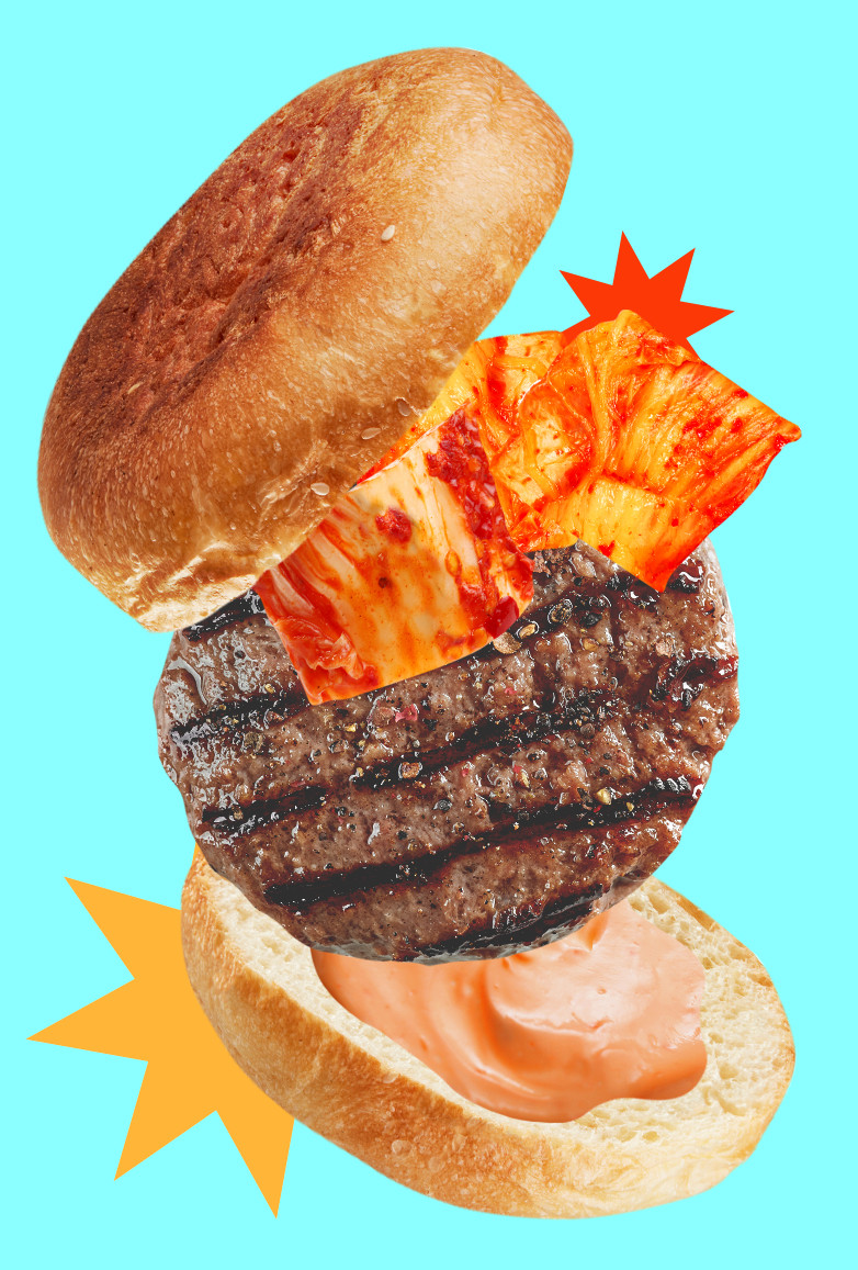 A photo illustration of a burger with kimchi and spicy aioli depicts Dakota Kim's Kimchi Juicy Lucy recipe.
