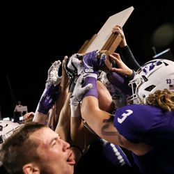 Lehi celebrates their 55-17 win over Skyridge in the 5A football state championship game at Rice-Eccles Stadium in Salt Lake City on Friday, Nov. 17, 2017.