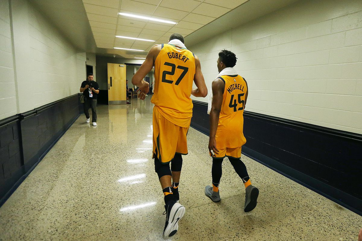 Utah Jazz center Rudy Gobert (27) and Donovan Mitchell (45) walk to the locker room after the Utah Jazz defeated the Oklahoma City Thunder in Game 2 of the NBA playoffs in Oklahoma City on Wednesday, April 18, 2018.