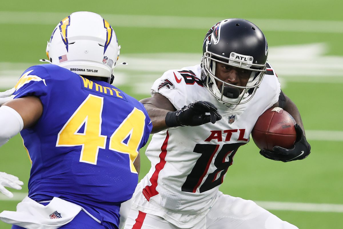Calvin Ridley #18 of the Atlanta Falcons carries the ball after a reception against Kyzir White #44 of the Los Angeles Chargers during the fourth quarter at SoFi Stadium on December 13, 2020 in Inglewood, California.