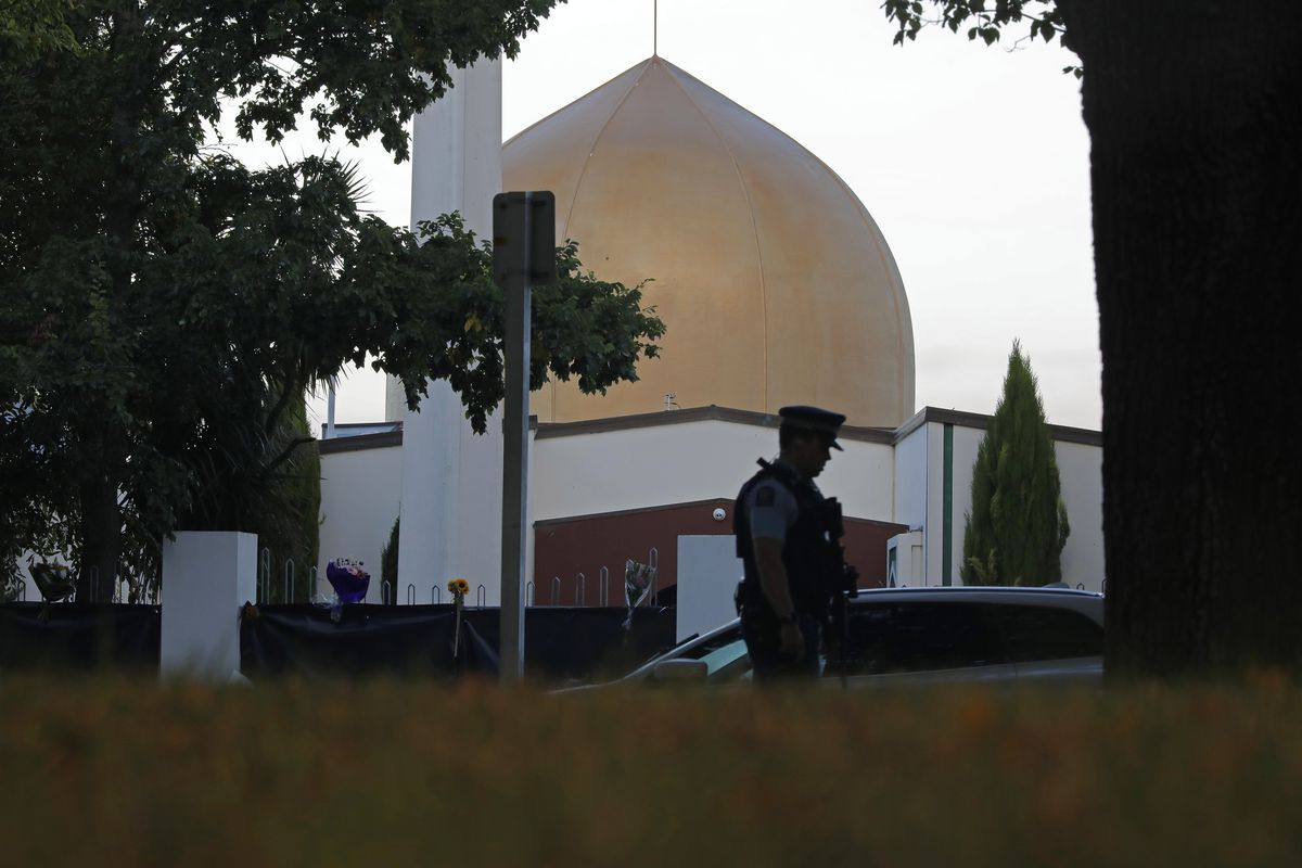 FILE - In this March 17, 2019, file photo, a police officer stands guard in front of the Al Noor mosque in Christchurch, New Zealand. The man authorities believe carried out the Christchurch mosque attacks is due to make his second court appearance via vi
