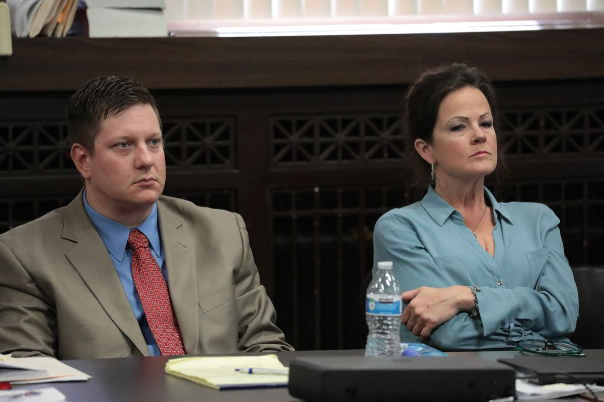 Former Chicago Police Officer Jason Van Dyke listens to closing statements with defense attorney Tammy Wendt during his trial for the shooting death of Laquan McDonald in 2018.